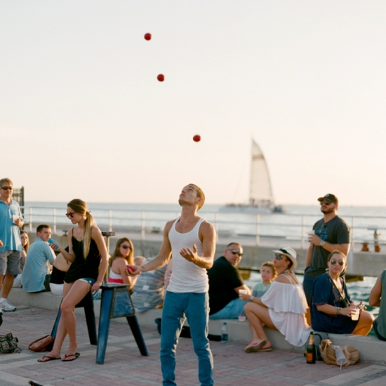 Key West street artist juggler by Sunset by Stefanie Kapra